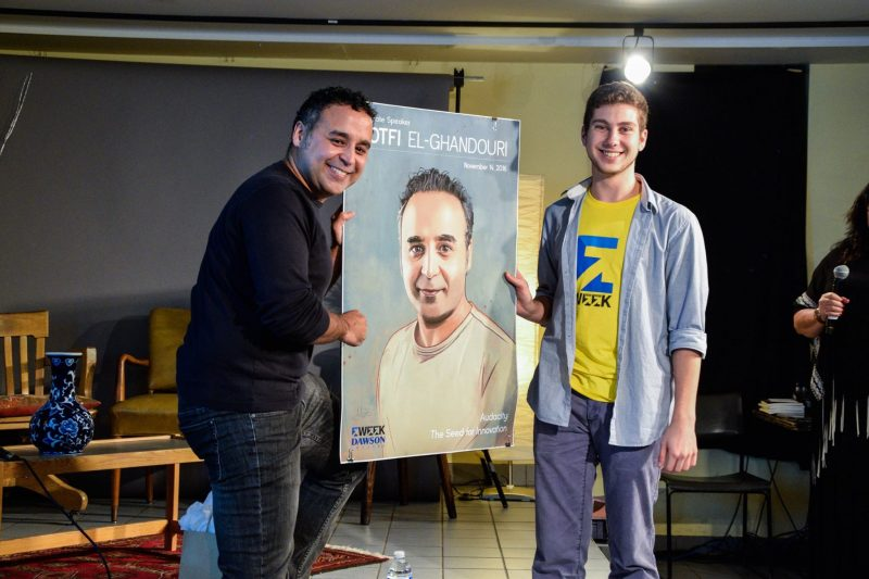 Lotfi accepting his portrait illustrated by Ali Hassanein