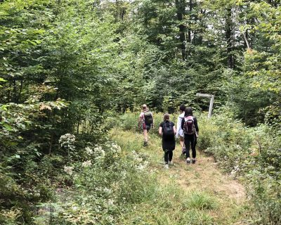 Students hiking the trails in Arundel