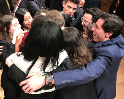 Model UN organizers share a group hug at the closing ceremonies